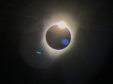 Captured from binoculars, the tail end of the August 2017 total solar eclipse event. Wallowa Whitman National Forest, OR.